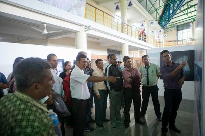 Niranjan Kunwar gives visiting school teachers and principals a guided tour. Photo: Shikhar Bhattarai