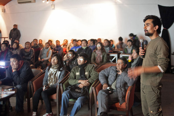Kathmandu International Art Festival (KIAF)'s Nischal Oli showing some of the photo works exhibited at the festival.Photo: Shikhar Bhattarai